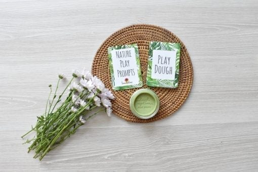 Nature cards flat lay featuring green natural play dough and flowers
