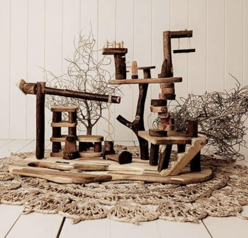 wooden tree house on floor - encouraging play