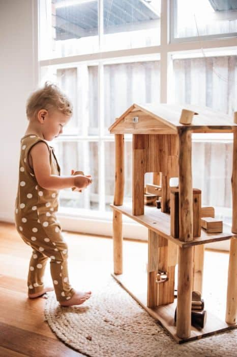 kid playing with Doll House
