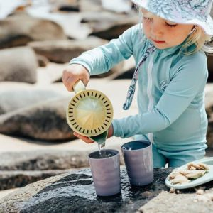 kid playing with sand bucket