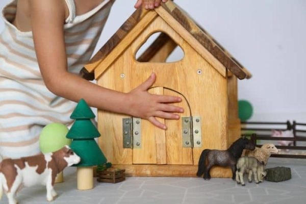 playing with wooden stable