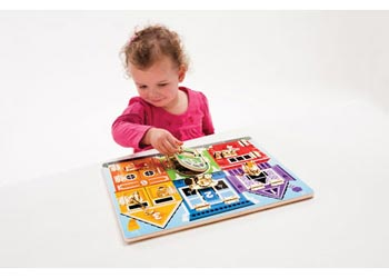 kid playing with Latches Board